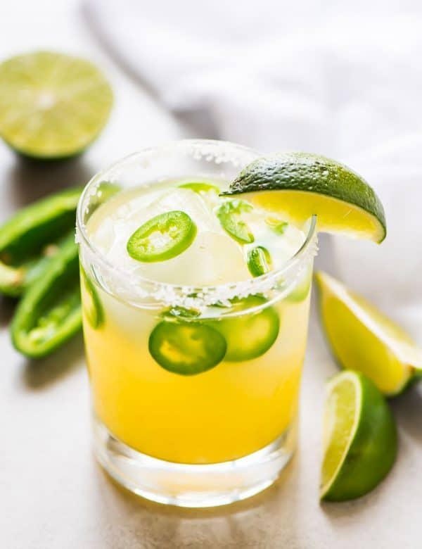 The BEST Spicy Margarita recipe. Skinny version made with fresh lime juice and agave. Add pineapple, strawberry, or keep it classic. Recipe at wellplated.com | @wellplated