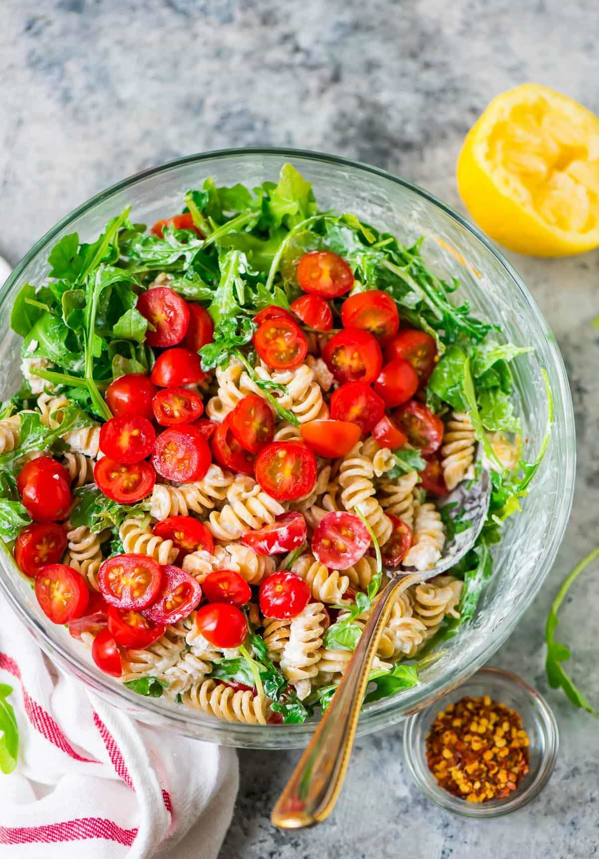 Easy, CREAMY Goat Cheese Pasta Salad with Arugula and Tomato. Ready in 15 minutes! Fast, fresh, and perfect for a picnic side dish, barbecues, and light summer meals. Recipe at wellplated.com   @wellplated