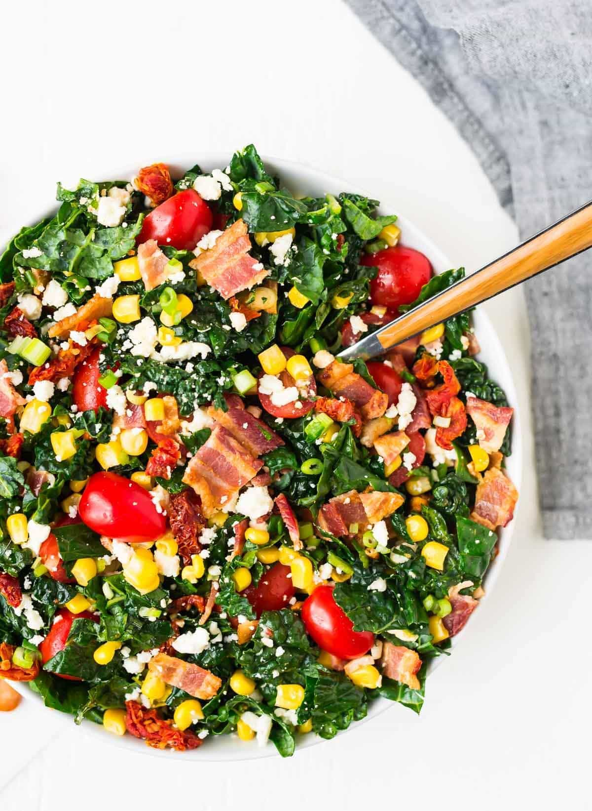 BLT chopped salad in a bowl with corn and feta