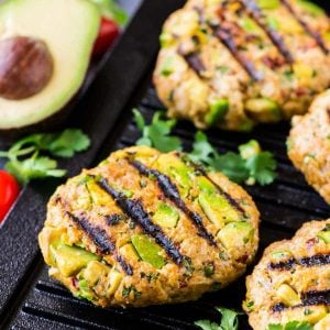 Chicken Avocado Burger – diced fresh avocado mixed with ground chicken or turkey, cilantro, and Tex-Mex spices, topped with chipotle yogurt sauce. Easy, healthy and ready in 30 minutes! Our favorite chicken burger recipe. Recipe at wellplated.com | @wellplated