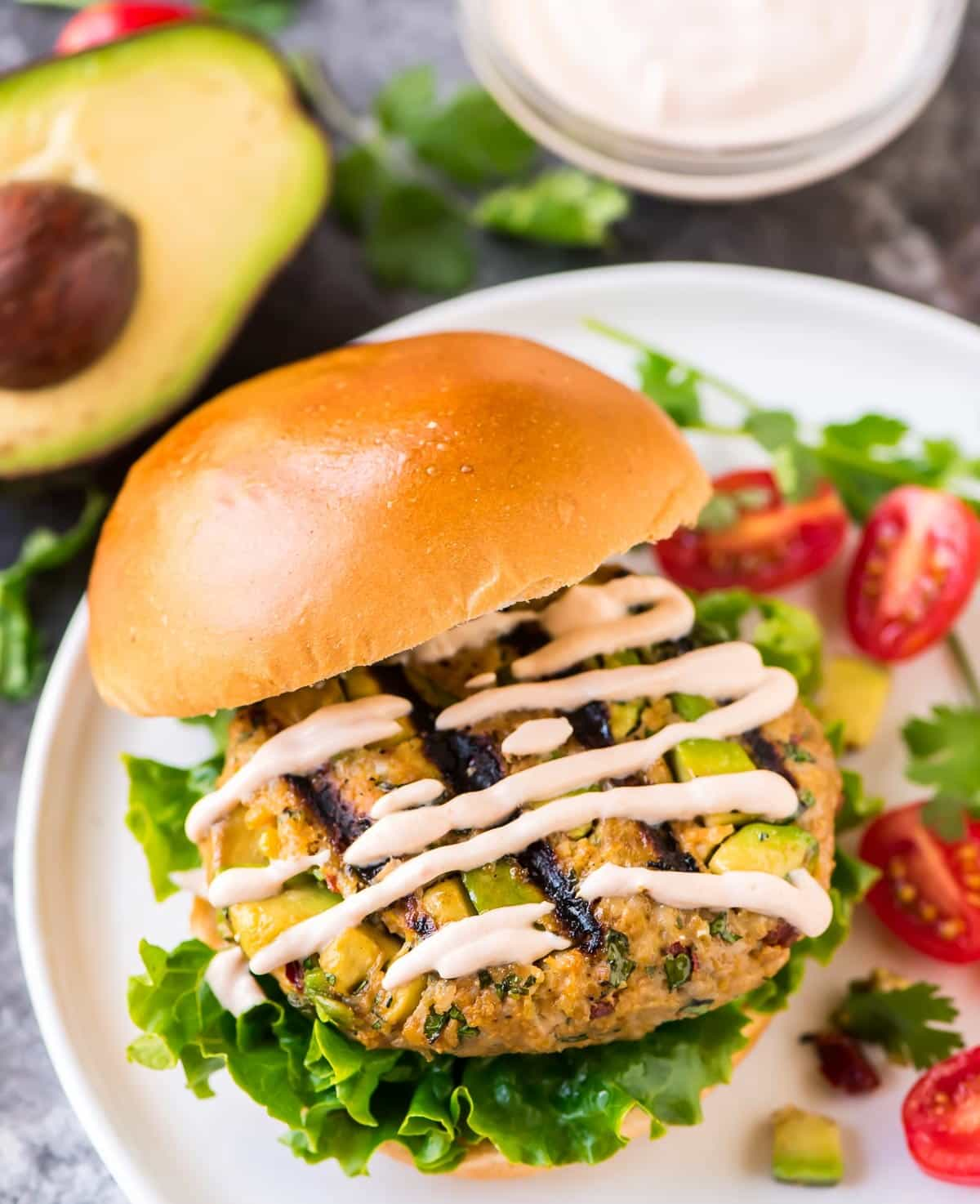 Chicken or Turkey Avocado Burgers. Easy, healthy, and SO flavorful! Top these chicken burgers with guacamole, salsa, cheese, or any of your favorite Tex-Mex toppings for an easy, healthy, 30 minute meal. Recipe at wellplated.com | @wellplated