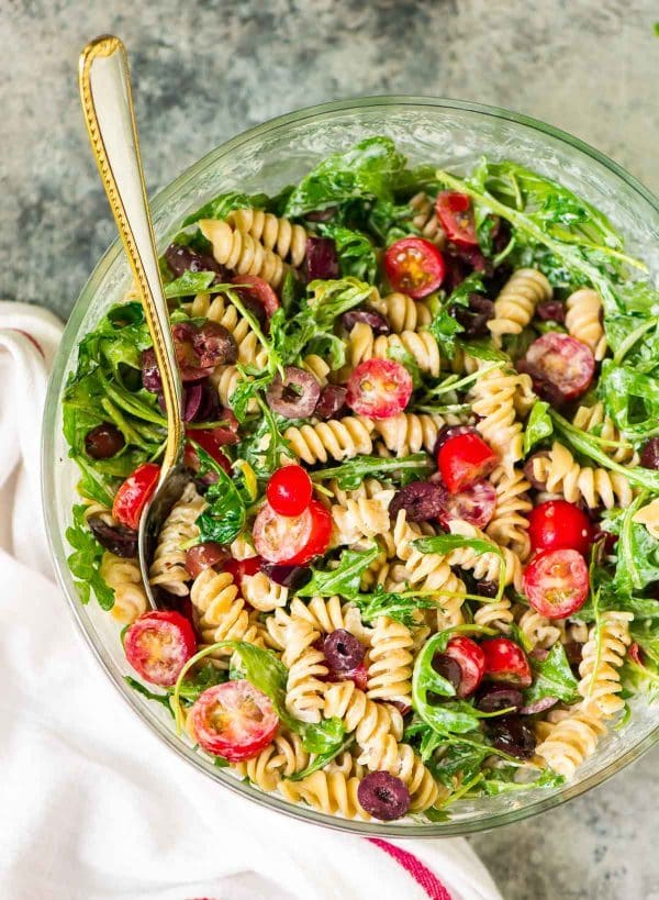 Creamy Goat Cheese Pasta Salad with Arugula and Tomato. Ready in 15 minutes! The perfect picnic recipe for summer barbecues or for a light summer meal. Recipe at wellplated.com | @wellplated