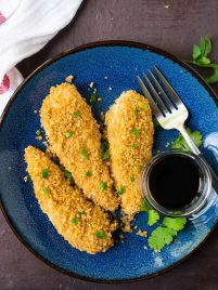 Oven baked Crispy Asian Chicken Tenders. Juicy, crispy, sweet, and spicy with a golden panko crust. Easy, healthy, and SO much better than take out! Recipe at wellplated.com   @wellplated