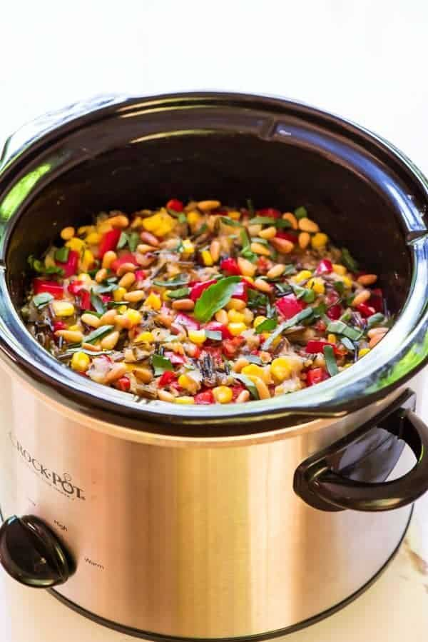 Crock Pot Summer Wild Rice Pilaf with Corn, Basil, and Bell Peppers. Easy, healthy, and the slow cooker does the work! Recipe at wellplated.com | @wellplated