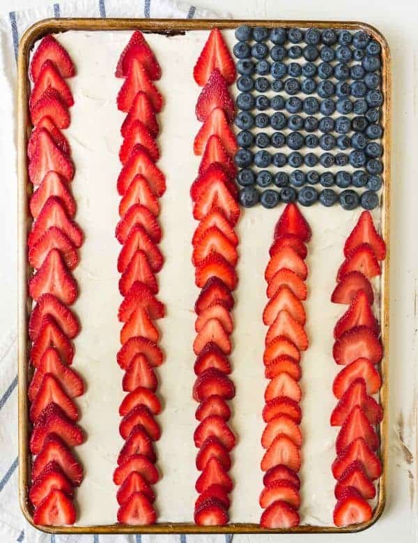 American Flag Cake. Easy to make and absolutely beautiful! Perfect for any patriotic-themed party. Recipe at wellplated.com | @wellplated
