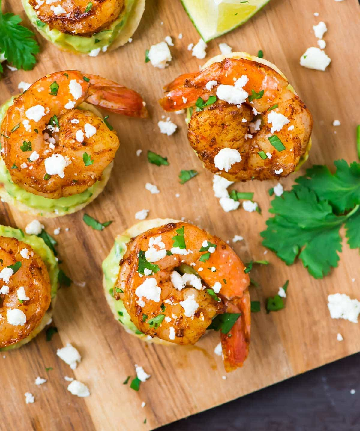 Spicy Guacamole Shrimp Bites. Easy, addictive appetizer recipe with shrimp, avocado, and tortilla chips. Recipe at wellplated.com | @wellplated