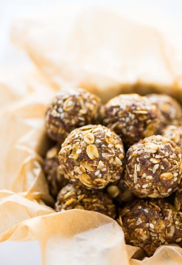 No Bake Ginger Cookie Healthy Energy Balls — easy, high protein, and great for your skin! Raw vegan recipe with oatmeal, coconut, warm spices, and flaxseed. Naturally sweetened and no food processor required! Recipe at wellplated.com | @wellplated