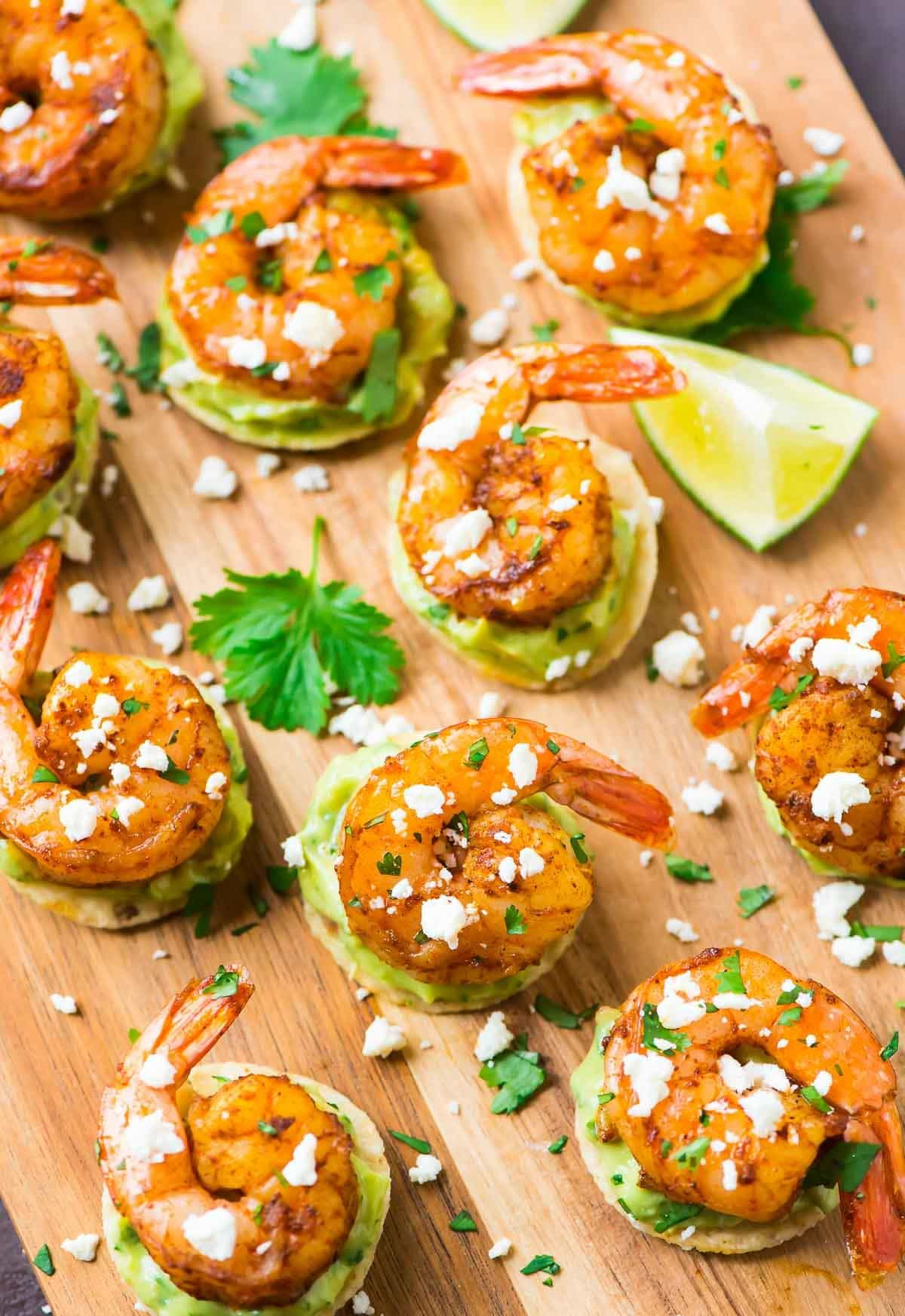 Spicy Guacamole Shrimp Bites. FAVORITE appetizer! Tortilla chips topped with creamy avocado, juicy roasted shrimp, and a squeeze of lime. Recipe at wellplated.com | @wellplated