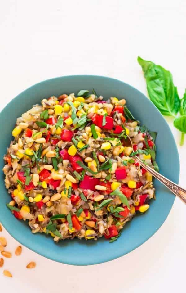Easy Slow Cooker Wild Rice Pilaf with Basil, Corn, and Bell Peppers. A fresh, healthy summer side dish that won't heat up your kitchen! Recipe at wellplated.com | @wellplated