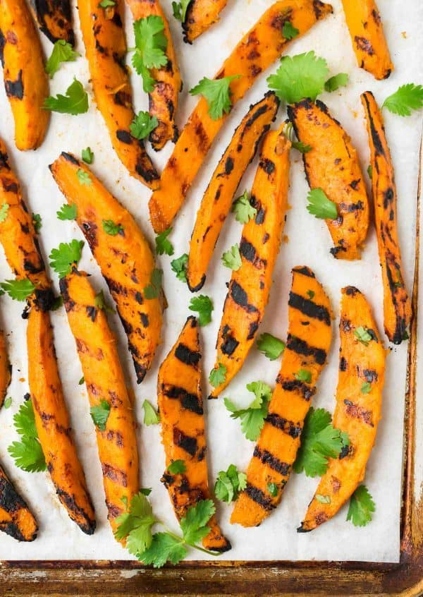 If you like oven fries, you will LOVE these crispy Grilled Sweet Potato Fries! Sweet, smoky, and perfect for healthy summer meals. Recipe at wellplated.com | @wellplated