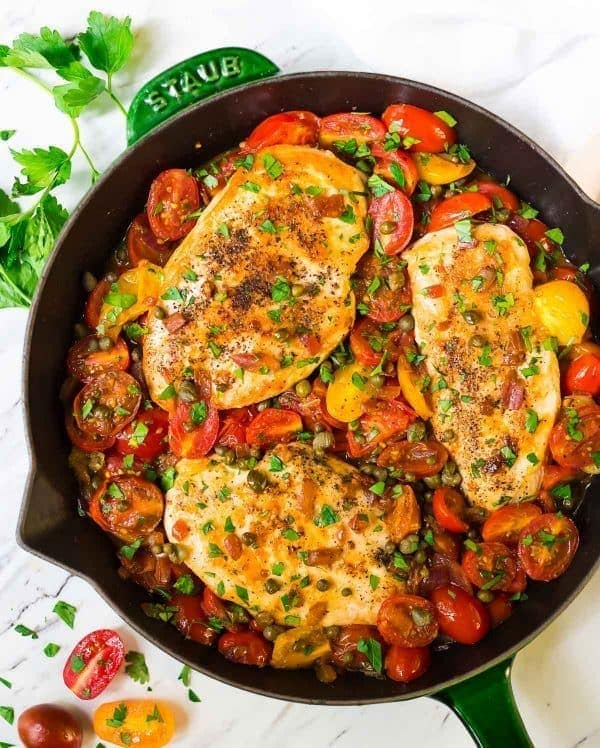 cast iron pan of skillet tomato chicken dinner