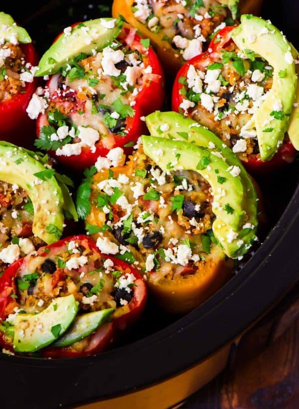 Crock Pot Stuffed Peppers with Quinoa and Black Beans. One of our favorite easy recipes! Delicious, freezer friendly, and can be made with ground turkey, ground chicken, or kept vegetarian. Recipe at wellplated.com | @wellplated