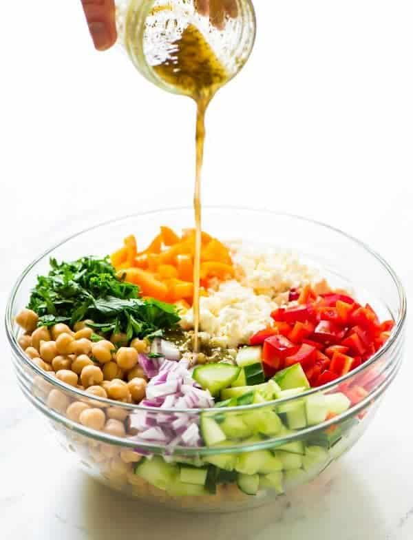 Chopped Greek Chickpea Salad with Feta, Cucumber, and Greek dressing. An easy, healthy recipe that's perfect for summer parties and light dinners. (Vegetarian, Gluten Free, Vegan friendly) Recipe at wellplated.com | @wellplated