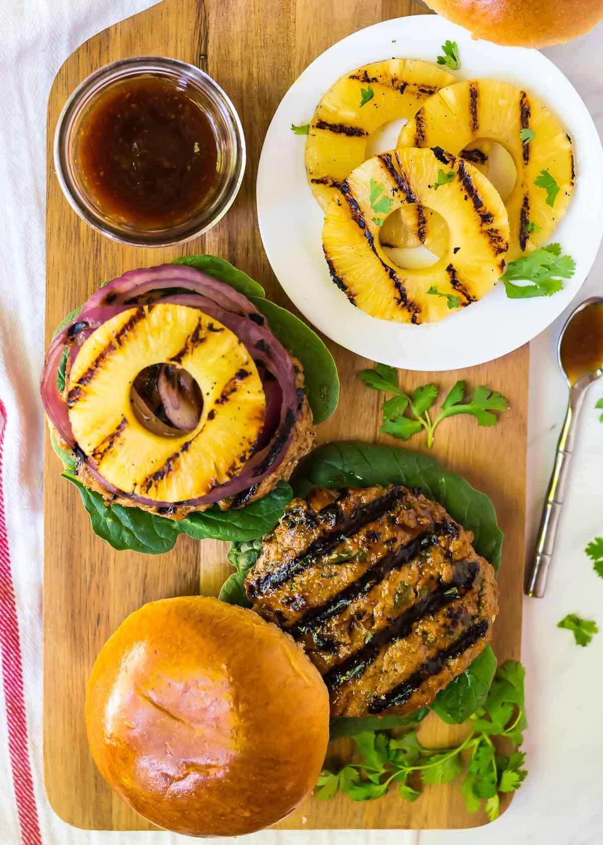 Hawaiian Teriyaki Burgers with Grilled Pineapple, Onion, and a sweet and savory teriyaki burger sauce. Recipe at wellplated.com | @wellplated