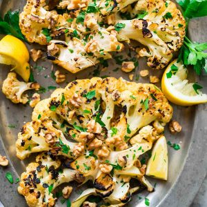 Grilled Cauliflower Steaks with honey, lemon, and toasted walnuts. Meaty, caramelized, and satisfying! Easy, low carb recipe that's perfect for a simple side or light dinner. {can be made vegan; gluten free} Recipe at wellplated.com | @wellplated