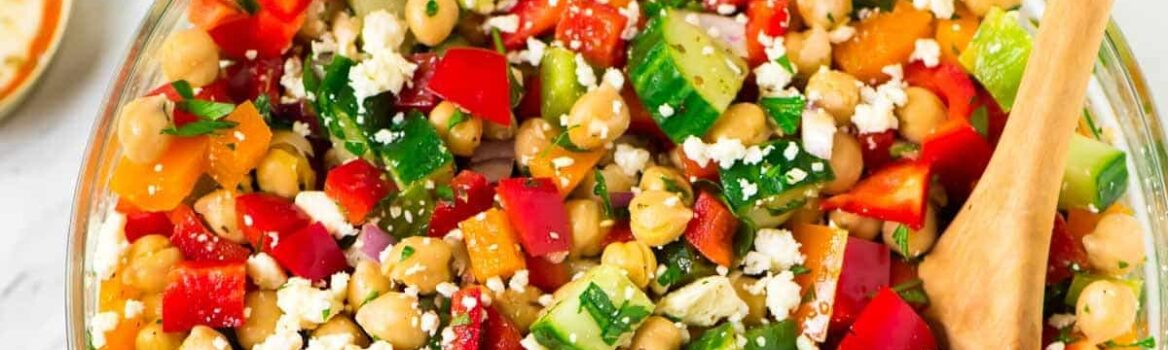 Healthy Mediterranean Chickpea Salad with feta, cucumber, bell peppers, and a simple Greek dressing. Fast, easy recipe that's perfect for a summer barbecue side dish or a main dish salad for a light dinner. {vegetarian, gluten free, vegan friendly} Recipe at wellplated.com | @wellplated