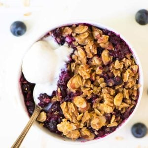 Slow Cooker Triple Berry Crisp – recipe works with fresh or frozen berries so you can enjoy summer fruit year round! Use any mix of blueberries, raspberries, or strawberries. Made with maple syrup and whole grains, this healthy fruit crisp cooks right in the crock pot and can be made gluten free or vegan. Enjoy it for dessert with whipped cream or for breakfast with yogurt. Recipe at wellplated.com | @wellplated
