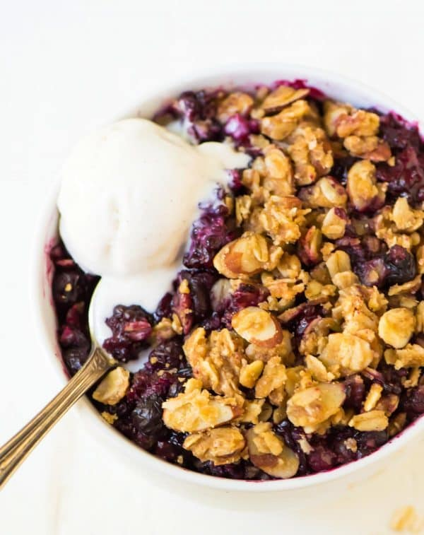 dish of Triple Berry Crisp topped with ice cream