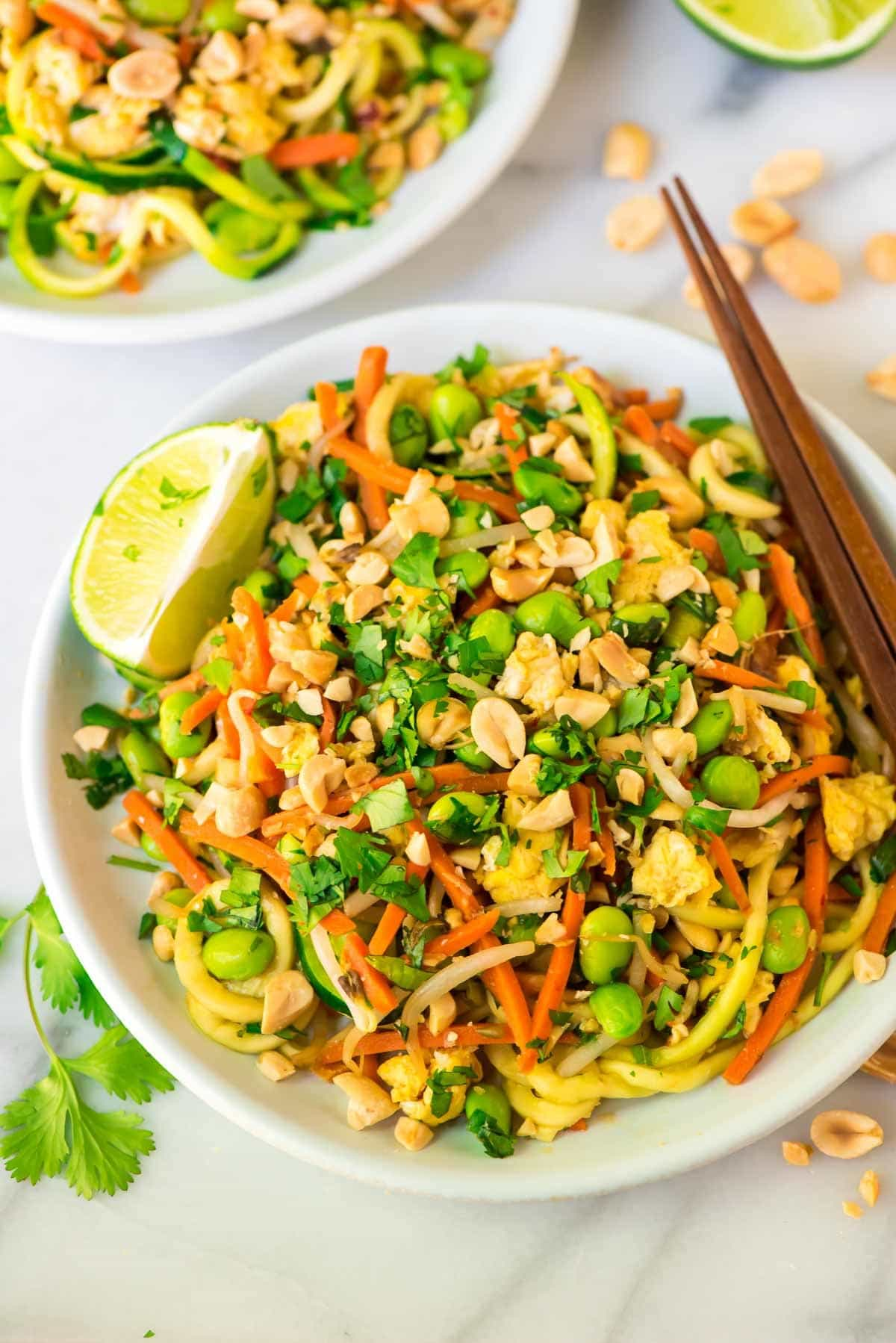 Peanut Vegetarian Pad Thai with Zoodles. Ultra flavorful, protein packed, and so fast and easy to make at home! A healthy one-pot meal that's ready in 30 minutes. Perfect for busy weeknights and families! Recipe at wellplated.com | @wellplated