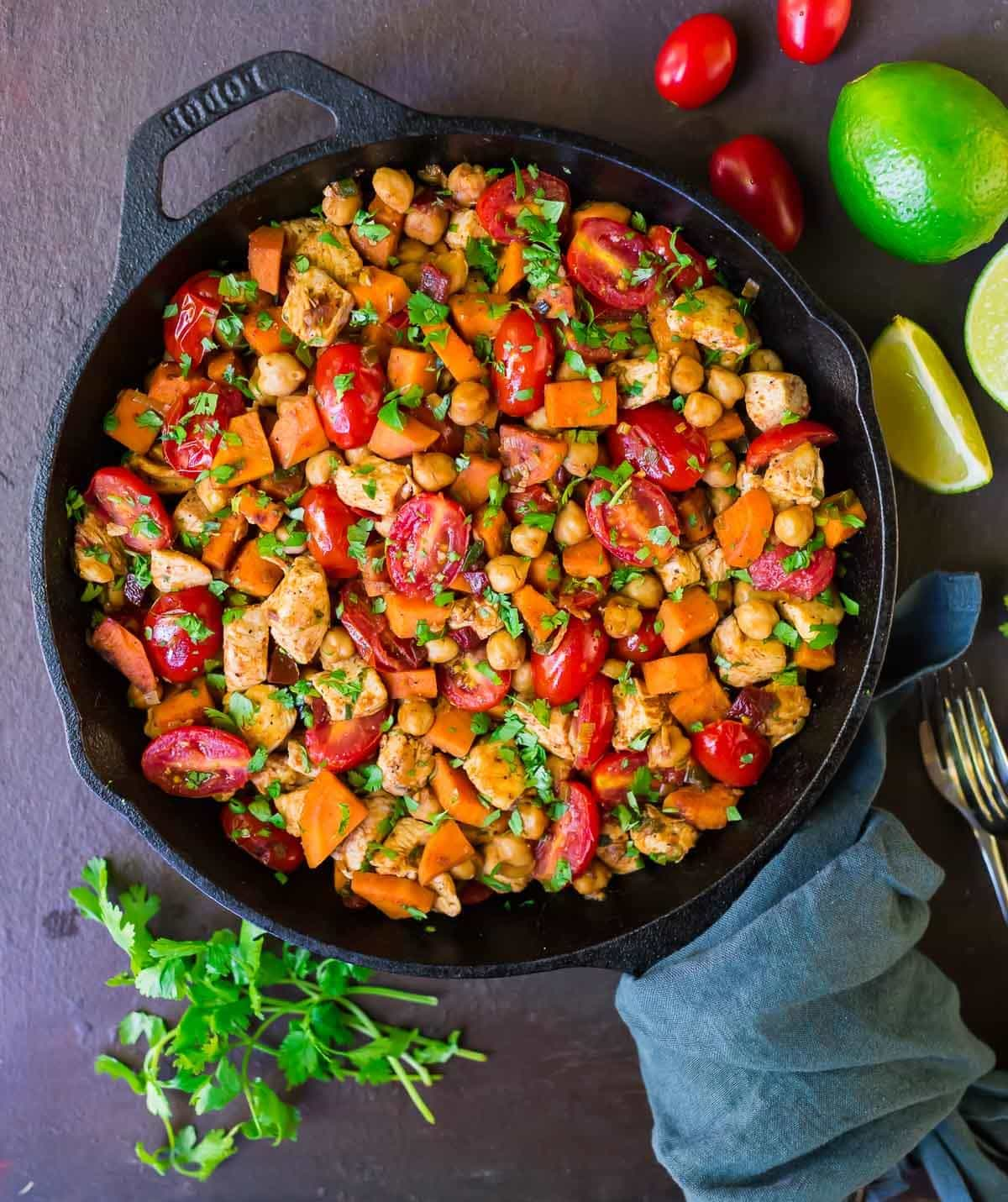 Chipotle Chicken Skillet with Sweet Potatoes, Tomatoes, and Chickpeas. FLAVORFUL, packed with healthy protein and fiber, and everything cooks in one pan! Recipe at wellplated.com | @wellplated
