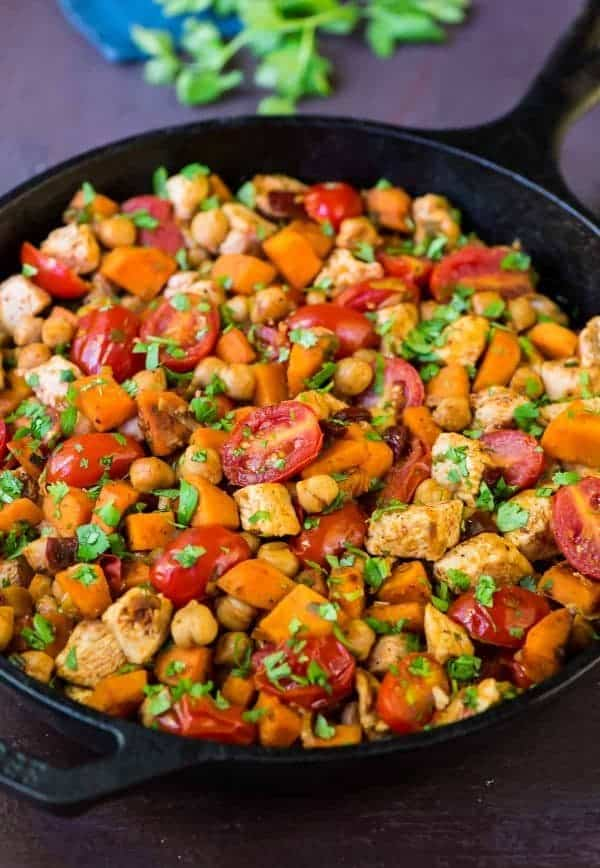 Easy and healthy Chipotle Chicken Skillet with Sweet Potatoes, Tomatoes, and Chickpeas. A great all-in-one meal! Recipe at wellplated.com | @wellplated