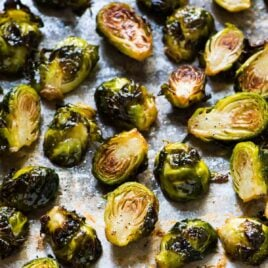 Roasted Brussels sprouts halves on a baking sheet
