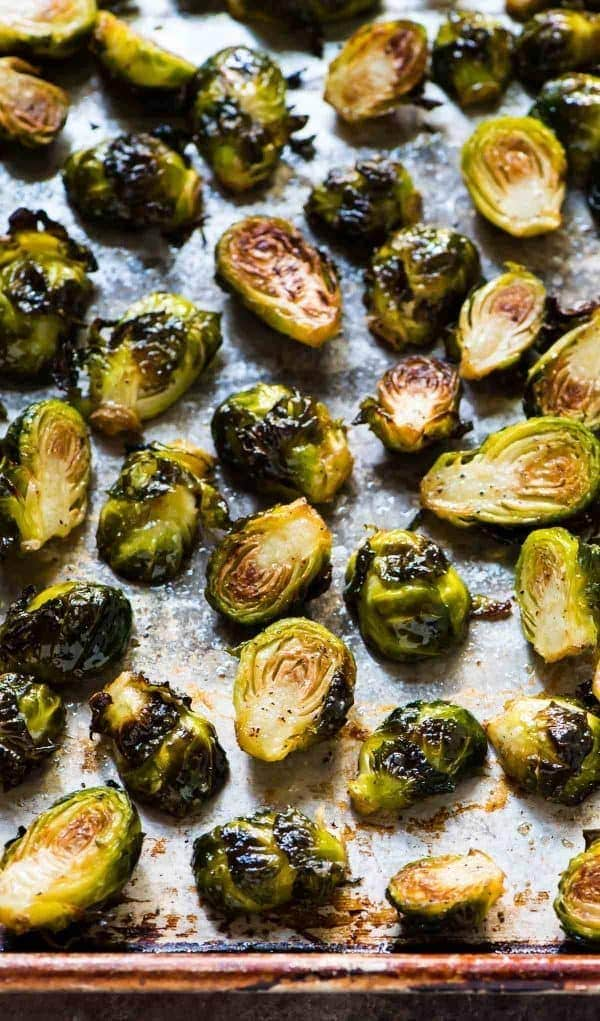Crispy roasted Brussels sprouts on a sheet pan with olive oil