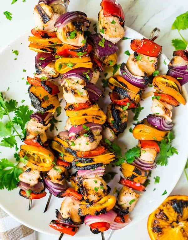 Grilled Orange Chicken Kabobs with the BEST orange, soy sauce and honey marinade. Tender, juicy, and with fresh veggies, it's the perfect healthy meal! Recipe at wellplated.com | @wellplated