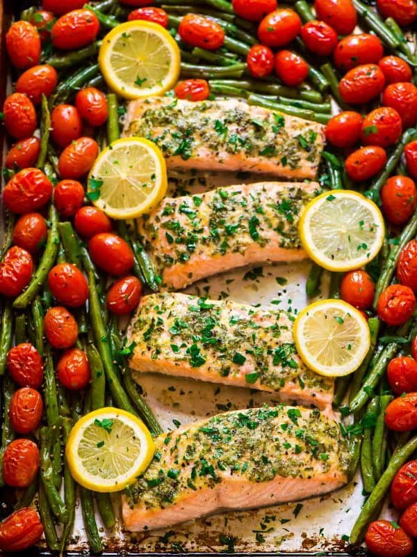 Garlic Salmon with Lemon Butter and Veggies. Our favorite healthy salmon recipe! Easy, ready in 30 minutes, and everything cooks on ONE pan. Recipe at wellplated.com | @wellplated