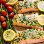 Easy Sheet Pan Baked Garlic Salmon with Lemon Butter and Veggies. Healthy, ready in 30 minutes, and everything cooks on ONE pan for easy clean up! Try it with green beans and asparagus, roasted tomatoes, or any of your favorite vegetables. {gluten free} Recipe at wellplated.com | @wellplated