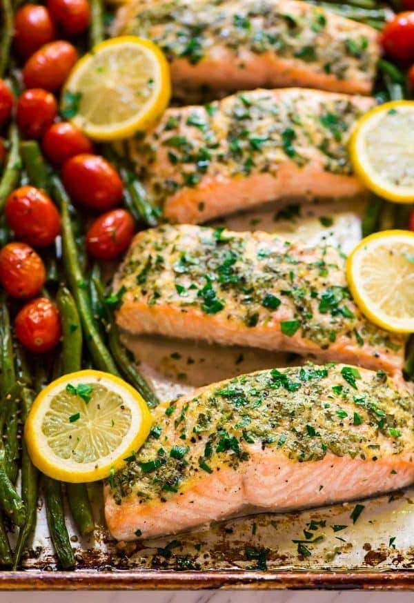 Easy Sheet Pan Baked Garlic Salmon with Lemon Butter and Veggies. Healthy, ready in 30 minutes, and everything cooks on ONE pan for easy clean up! Try it with green beans and asparagus, roasted tomatoes, or any of your favorite vegetables. {gluten free} Recipe at wellplated.com   @wellplated