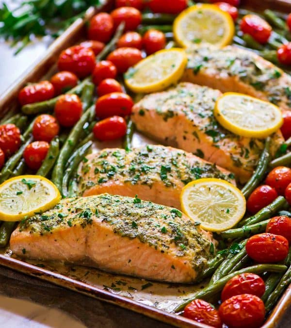 Easy Sheet Pan Garlic Salmon with Lemon Butter and Veggies. Healthy, 30 minute meal with no clean up! Recipe at wellplated.com   @wellplated