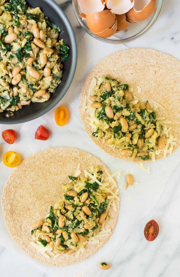 Healthy Breakfast Quesadilla recipe. Easy, make ahead recipe with scrambled eggs, spinach, cheese, and white beans. Simple, filling, and freezer friendly! Recipe at wellplated.com   @wellplated
