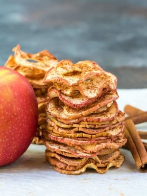 Crispy Baked Apple Chips. Simple oven recipe with just cinnamon and apples, no sugar or dehydrator needed! Easy, healthy, and so much better than store bought. Kids love them and they are great for gifts and healthy snacks. Recipe at wellplated.com