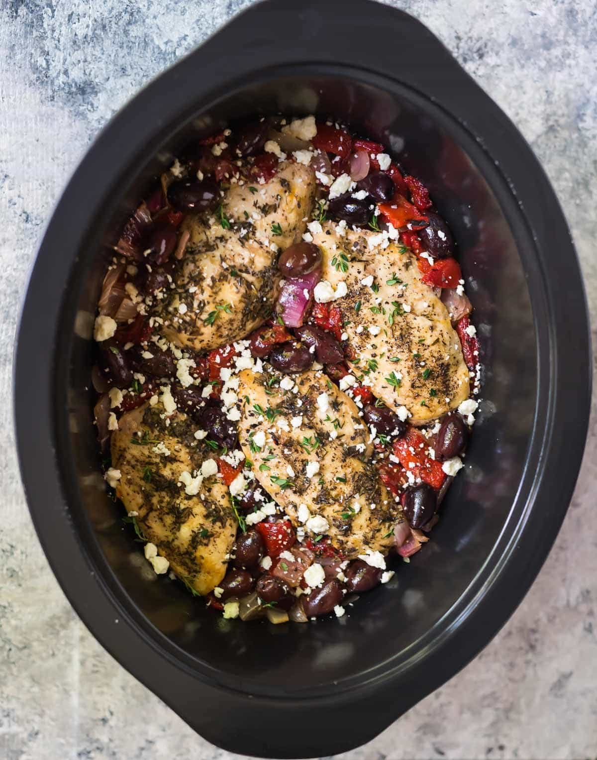 Greek Chicken, done the easy way in the slow cooker! The chicken is moist and the greek chicken marinade with red wine vinegar gives it incredible flavor. Recipe at wellplated.com