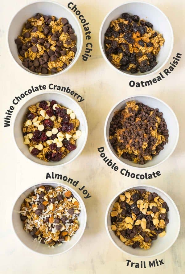 white bowls filled with popular mix-ins for no bake energy balls