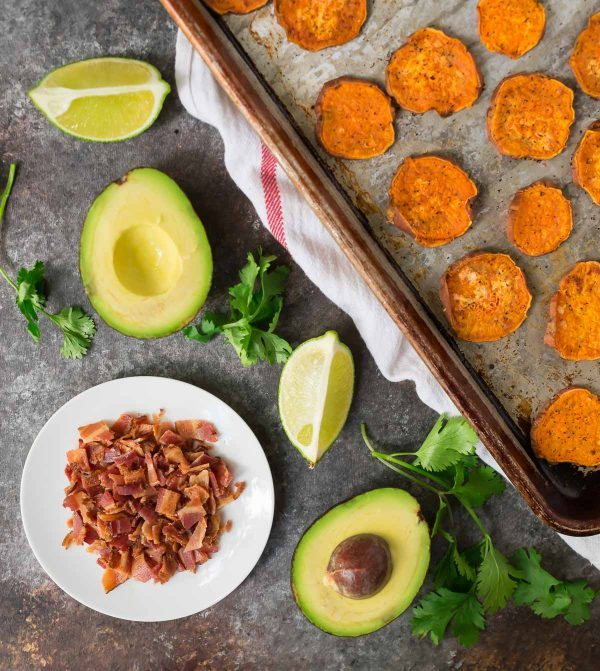 ingredients to make a sweet potato appetizer - sweet potato slices, crisp bacon, and avocados