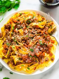 Healthy weeknight Turkey Bolognese. Easy recipe and tastes authentic! The thick, rich sauce tastes like it's been simmering all day, but is ready in minutes, not hours. Recipe at wellplated.com.