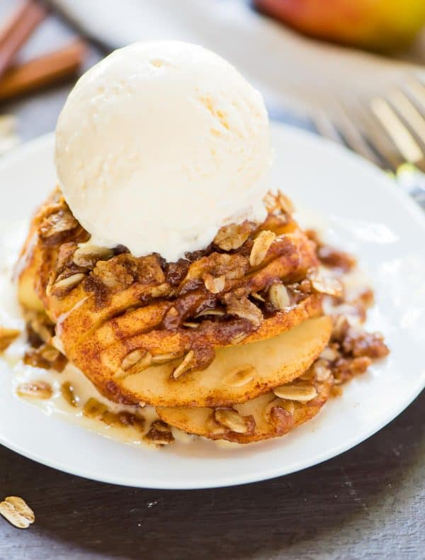 Healthy Hasselback Apples with Buttery Cinnamon Streusel. Easy and delicious fall dessert! This simple recipe is perfect for using up extra apples, and beautiful enough to be worthy of a holiday celebration like Thanksgiving and Christmas.
