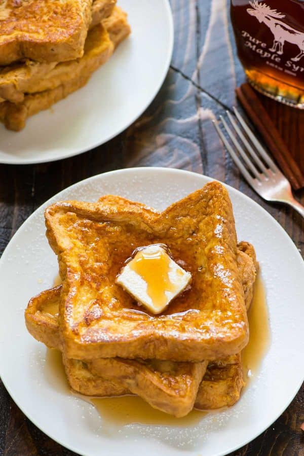Pumpkin French Toast – healthy, easy, and a great way to use up extra canned pumpkin puree! Greek yogurt makes the custard thick and rich. Serve with maple syrup or even cream cheese.