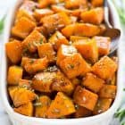 Easy Maple Cinnamon Roasted Butternut Squash. Sweet cubes of butternut squash tossed with maple syrup, cinnamon, and rosemary, roasted to caramelized perfection. Our family's favorite Thanksgiving, Christmas, or any time you need a simple and healthy weeknight side.