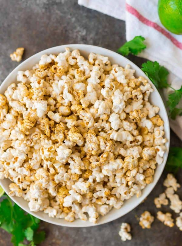 "Easy ""Cheesy"" Taco Popcorn. Made with pantry spices, nutritional yeast, and lime zest. A healthy, flavorful snack! Perfect for the office, parties, or movie nights. #popcorn #tacopopcorn"