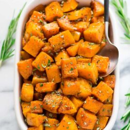Maple Cinnamon Roasted Butternut Squash with Rosemary. Butternut squash cubes tossed with maple syrup and cinnamon, then roasted until sweet, caramelized, and absolutely delicious! An easy, healthy side dish recipe for Thanksgiving, Christmas, or even a simple weeknight!