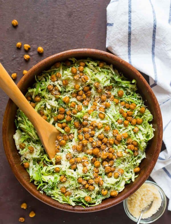 Shaved Brussel Sprouts Salad with Crispy Chickpea Croutons – Raw brussels sprouts, , Parmesan cheese, and the best creamy Caesar dressing. Easy make ahead recipe that's perfect for a holiday side dish or meal prep lunches.