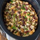 Incredible Slow Cooker Stuffing with Apples, Cranberries, and Pecans. Easy crockpot method that frees up the oven on Thanksgiving. Keep vegetarian or add chicken sausgage or mushrooms. #thanksgiving #stuffing #slowcooker #crockpot