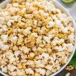 """Easy """"Cheesy"""" Taco Popcorn. Chili powder, fresh lime zest, and nutritional yeast make a delicious, healthy, dairy free party appetizer or office snack. Perfect for movie nights! #popcorn #tacopopcorn #dairyfree #healthysnack #healthyappetizer"""
