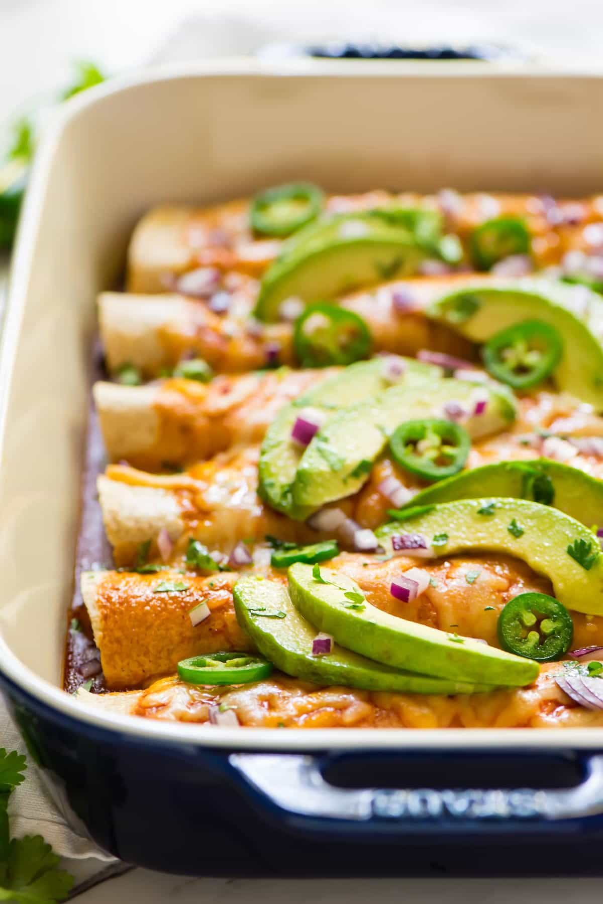 Spicy vegetarian enchiladas with avocado