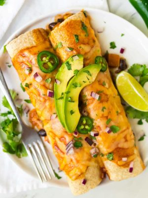 Easy, filling, and delicious Vegetarian Enchiladas with Butternut Squash, Black Beans, and Cheese. A healthy, flavorful casserole recipe that's freezer friendly and perfect a for meatless Monday.