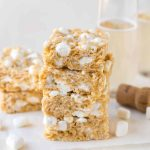 Soft, ooey-gooey, BOOZY Marshmallow Rice Krispie Treats made with Champagne! This easy recipe with marshmallows, Rice Krispies cereal, and sparkling wine is the perfect surprise dessert for New Year's Eve parties. This recipe comes out perfectly every time. Like marshmallow treats for grown ups! #ricekrispietreats #marshmallowtreats #champagne #newyearseve