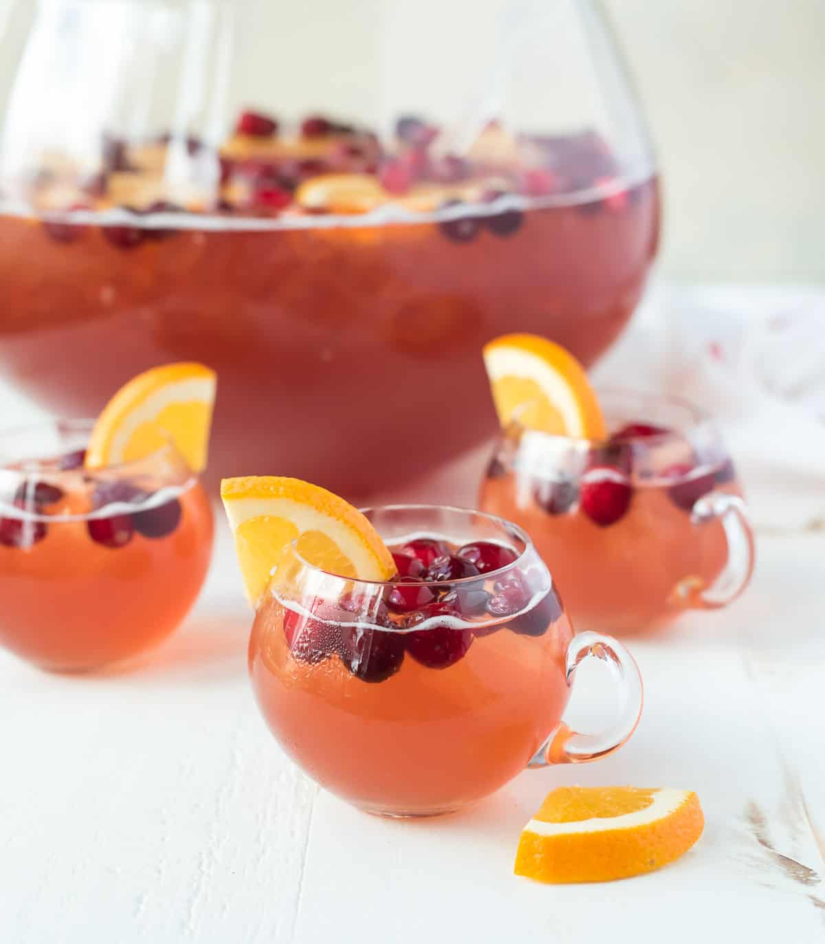 Sparkling cranberry punch with rum, champagne, and apple cider